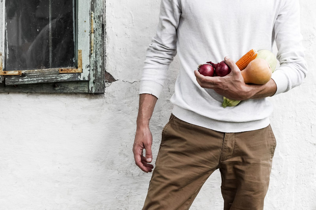 man holding fruits and vegatables
